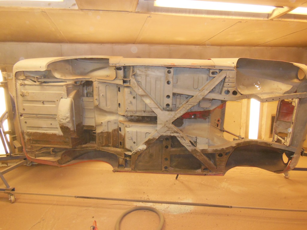 Underside of the shell being blasted free from all the old paint and underseal